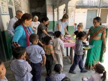 Helaina (far right) distributing books and pencils to children from disadvantaged backgrounds attending government school number 8. These materials were kindly donated by her family and friends in the UK.